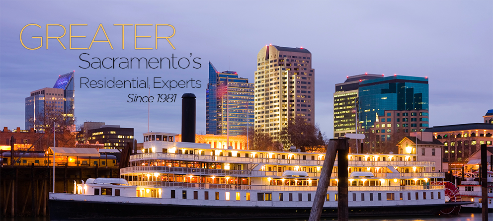 "Sacramento city in the background, at dusk with a large paddle boat in the foreground. Text on top of image in the upper left side says ""Greater Sacramento's Residential Experts Since 1981""."